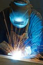 Welder at factory workshop working with electrode semi automatic arc welding in manufacture production plant Stock Images