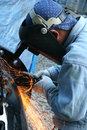 Welder with grinder Royalty Free Stock Image
