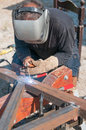 Welder man using an arc Stock Image
