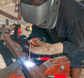Welder man using an arc Stock Photography