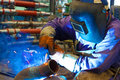Welder master with protective helmet digested tubes photography Royalty Free Stock Photos