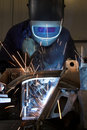 Welder welding a metal part Royalty Free Stock Photos
