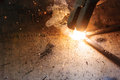 Welder welding sparks steel in factory bodypart Stock Photography