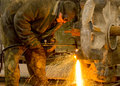 Welder at work sparks and drops of molten metal during of Stock Photos