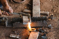 Welder worker cutting steel pipe using metal torch Royalty Free Stock Images