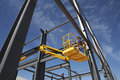 Welder working from cherry picker on steel framing structure Stock Images
