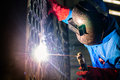 Welder working in industrial factory Royalty Free Stock Photo