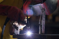 Welding metal with lots of sparks Royalty Free Stock Image