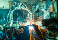 Welding robots movement in a car factory Royalty Free Stock Images
