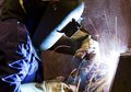 Welding with sparks man reflection of Royalty Free Stock Photo