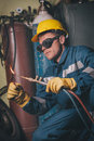 Welding work master in protective clothing for in the workshop Stock Images
