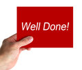 Well done card in hand with lettering on white background Stock Photography