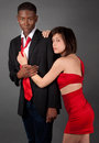 Well dressed interracial couple an image of an attractive young in fancy clothing Royalty Free Stock Photos
