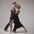 Well-dressed retro couple dancing tango Royalty Free Stock Photo