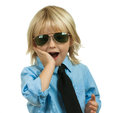 Well-dressed, surprised cute boy on white Stock Image