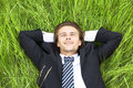 Well-dressed young businessman is resting Royalty Free Stock Photo