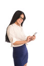 Well dressed young woman using smartphone looking camera Stock Photos