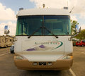 A well maintained class a motor home an allegro coach waiting to be serviced at fort myers florida Stock Photos
