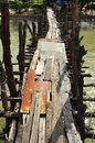 Well maintained pier phuket repaired here with any piece of wood found nearby thailand Royalty Free Stock Photos
