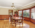 Well put together dinning room with hardwood floor lit and dark wood set Stock Photography