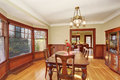 Well put together dinning room with hardwood floor lit and dark wood set Royalty Free Stock Photo