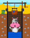 Well trap a humorous illustration of a cow trapped inside a Royalty Free Stock Images