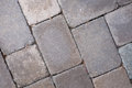 Well worn cobblestone pavers in pale tan and pink Royalty Free Stock Photo