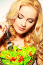 Wellbeing portrait of a beautiful young woman eating vegetable salad healthy life diet Stock Image