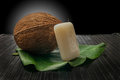 Wellness coconut and soap on black cutting board Stock Photo
