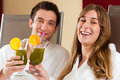 Wellness couple with chlorophyll shake in spa young men and women drinking Royalty Free Stock Photos