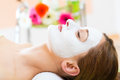 Wellness woman getting face mask in spa receiving facial for clean and moist skin Royalty Free Stock Image