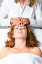 Wellness - woman getting head massage in Spa Royalty Free Stock Photos