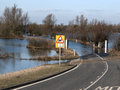Welney old bedford river and new bedford rive floods blocking the road to the village of Royalty Free Stock Image