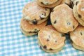 Welsh cakes stacked on plate on gingham napkin Royalty Free Stock Image