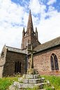 Weobley church and cross st peter st paul with the graveyard stone in the foreground herefordshire england uk western europe Royalty Free Stock Images