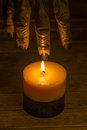 Werewolf hand reaching for a candle and halloween close up Stock Photography