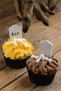 Werewolf hand reaching for a halloween cupcake the close up Royalty Free Stock Photos