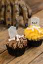 Werewolf hand slowly reaching for the halloween cupcakes close up Royalty Free Stock Images