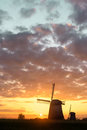 West Friesland, Netherlands, 2015: Two windmills at sunset on an Royalty Free Stock Photo