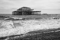 West pier ruins in black and white brighton beach england shot of the taken on a stormy day the lay derelict for years before Royalty Free Stock Photography