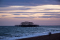 West pier ruins at sunset brighton beach england evening shot of the the lay derelict for years before being destroyed by fire Royalty Free Stock Photography