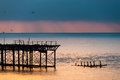 The west pier at sunset in brighton uk Stock Photo