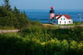 West quoddy head lighthouse lies on the easternmost point of the united states in lubec maine it is also the first place the sun Royalty Free Stock Photography