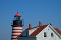 West quoddy lighthouse and keepers quarters the candy striped red white tower the home on a beautiful afternoon Royalty Free Stock Images