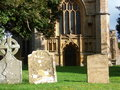 West wall medieval church seen trees tombstones churchyard Stock Photo