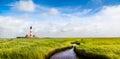Westerheversand lighthouse at North Sea, Schleswig-Holstein, Germany Royalty Free Stock Photo