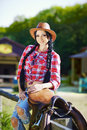Western,cowboy,cowgirl,rodeo.Cowgirl in western style on the far Royalty Free Stock Photo