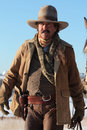 Western gunslinger a cowboy against a bright blue sky he s wearing a holster with a pistol Stock Photography