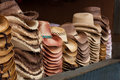 Western hats on display stacks of a dark background Stock Image