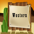 Western text frame with cactus and rope on old wood background Royalty Free Stock Photo